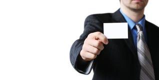 拿着名片的人手中 免版税库存照片