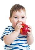 拿着和吃红色苹果的男婴画象 免版税图库摄影