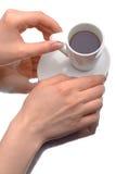 拿着咖啡杯的二个现有量 免版税库存图片