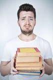 拿着哀伤的学员的书 免版税图库摄影