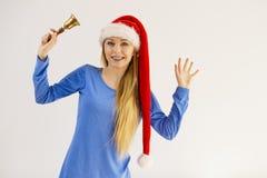 拿着响铃的圣诞节妇女 库存照片