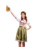 拿着啤酒的传统巴法力亚礼服的妇女 库存图片