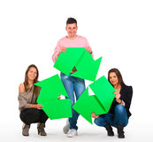 拿着回收符号的三个人 免版税库存照片