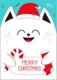 拿着圣诞快乐文本,棒棒糖,袜子的白色猫 逗人喜爱的滑稽的漫画人物 库存图片