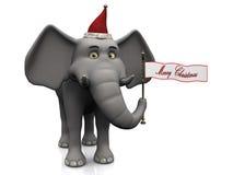 拿着圣诞快乐标志的动画片大象。 免版税库存图片