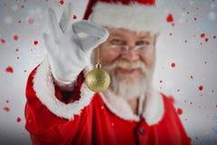 拿着圣诞节中看不中用的物品的圣诞老人的综合图象 免版税图库摄影