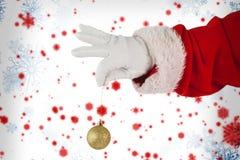 拿着圣诞节中看不中用的物品的圣诞老人的综合图象 库存照片