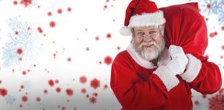 拿着圣诞节大袋的圣诞老人画象的综合图象 图库摄影