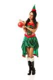 拿着圣诞节泡影的妇女 免版税库存图片