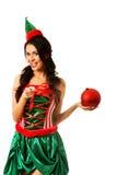 拿着圣诞节泡影的妇女 免版税库存照片