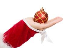 拿着圣诞节球的妇女的现有量 免版税库存图片