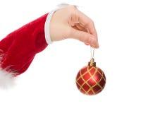 拿着圣诞节球的妇女的现有量 库存照片
