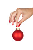 拿着圣诞节球 免版税图库摄影