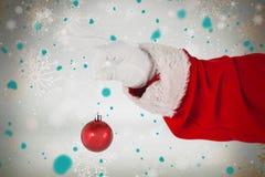 拿着圣诞节装饰品的圣诞老人的综合图象 库存照片