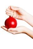 拿着在一个空白背景的妇女的现有量圣诞节球 库存图片