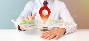 拿着在地图的商人一个3d翻译别针持有人 免版税库存图片