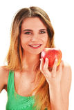 拿着在她的现有量的少妇一个红色成熟苹果 免版税库存图片