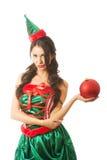 拿着在左手的严肃的妇女圣诞节泡影 库存照片
