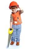 拿着在木头的小男孩一把引形钢锯 库存照片