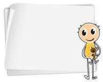 拿着在白皮书旁边的男孩一个玩具熊 免版税图库摄影