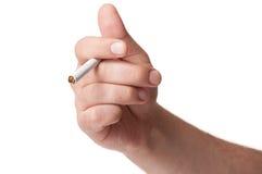 拿着在白色背景的白人手一根香烟 图库摄影