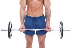 拿着在白色背景的肌肉人杠铃 免版税图库摄影