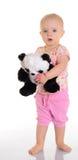 拿着在空白背景的婴孩长毛绒玩具 图库摄影