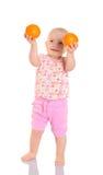拿着在空白背景的愉快的婴孩桔子 库存照片