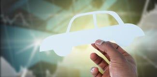 拿着在纸的手的综合图象一辆汽车 免版税库存图片