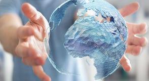拿着在行星地球3D翻译的商人全球网络 库存图片
