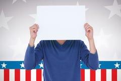 拿着在面孔前面的人的综合图象空白的标志 免版税库存图片