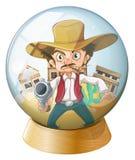 拿着在水晶球里面的牛仔一杆枪 免版税库存图片