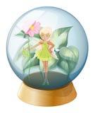 拿着在水晶球里面的神仙一朵花 免版税库存图片