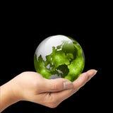拿着在他的手上的一个人地球 免版税图库摄影