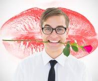 拿着在他的牙的万人迷行家的综合图象一朵红色玫瑰 库存照片