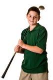 拿着高尔夫俱乐部的年轻男孩 免版税库存照片