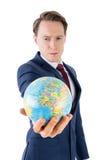 拿着地球地球的严肃的商人 库存图片
