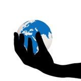 拿着地球地球的手 免版税库存图片
