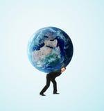 拿着地球的人 免版税库存照片