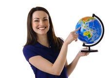 拿着地球的女孩 免版税库存图片