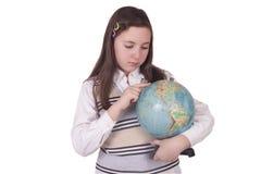 拿着地球的学校女孩 免版税库存照片