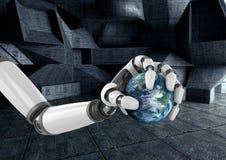 拿着地球的机器人手 库存图片