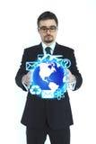 拿着地球的生意人 免版税图库摄影