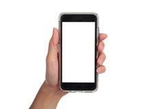 拿着垂直的巧妙的电话,用途裁减路线的女性手 库存图片