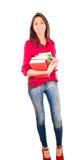 拿着堆书的年轻拉丁女孩 免版税图库摄影