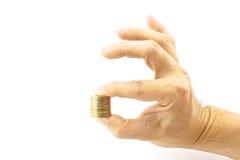 拿着堆金币的手 图库摄影