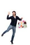 拿着塑料袋的年轻人被隔绝在白色 免版税库存图片