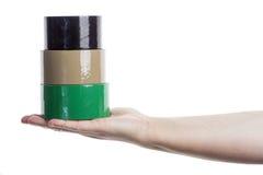 拿着塔的手由橡皮膏制成 库存照片