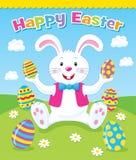 拿着复活节彩蛋的复活节兔子 免版税库存图片