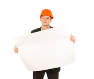 拿着大厦图纸的年轻男性工程师 免版税图库摄影
